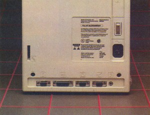 The rear of the Mac. Note the icon labels. The bottom row of connectors is for (from left) the mouse, second floppy disk, printer, modem and speaker.